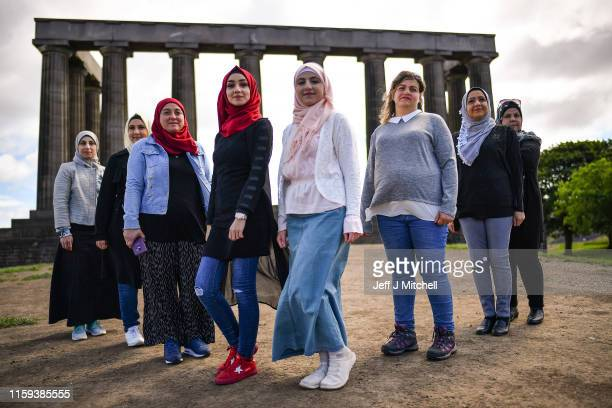 A group of Syrian refugees hold a photo call on Calton Hill as they look to raise £25000 to put on their play Euripdes' The Trojan Women on July 1...