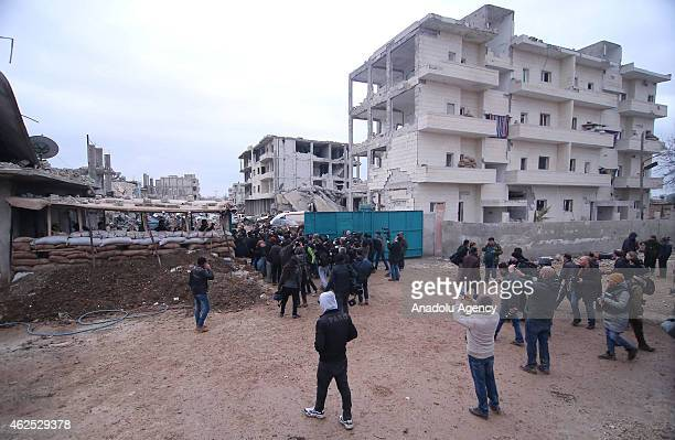 Group of Syrian who shelter in Turkey due to clashes in their country, enter in Kobani after they receive permission on January 30, 2015.