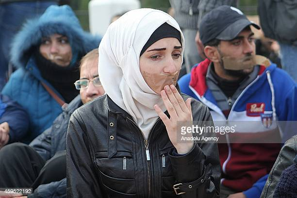 A group of Syrians fled from civil war in Syria stage sitin demonstration that demands housing right from Greek Government in Athens Greece on...