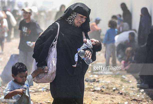 A group of Syrians fled from clashes cross Turkish Syrian border to take shelter in Turkey on June 15 2015 in Sanliurfa's Akcakale district Turkey...
