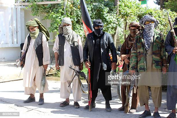 A group of Taliban members are seen as they surrender to the authorities in Cevizcan Afghanistan on September 09 2016