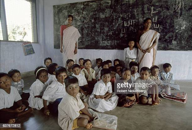A group of Tamil children sit on the floor of a classroom January 1 1998 in an elementary school in Jaffna Sri Lanka