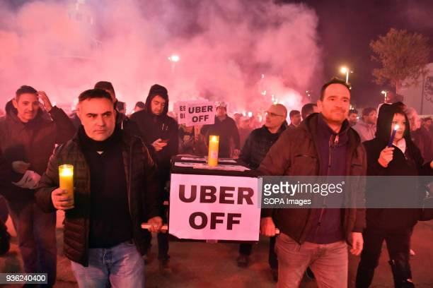 A group of taxi drivers in Barcelona with a coffin and placard Uber Off during the protest of taxi drivers in Barcelona against Uber and Cabify...
