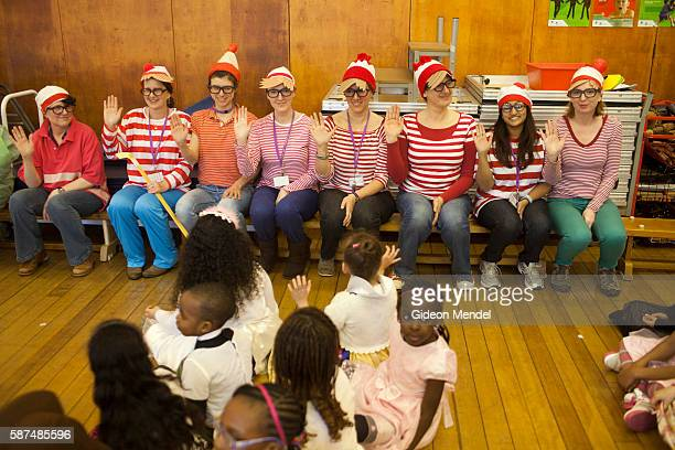 A group of teachers are all dressed up as the Where's Wally character during the school assembly at Kingsmead Primary School in Hackney on World Book...