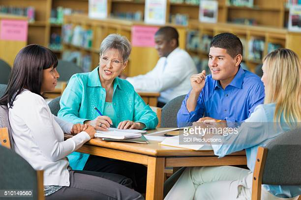 Group of teachers meet in library