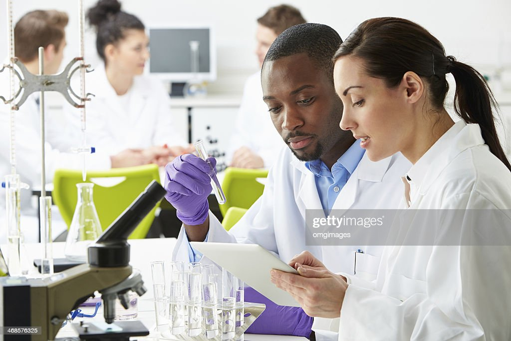 Group Of Technicians Working In Laboratory : Stock Photo