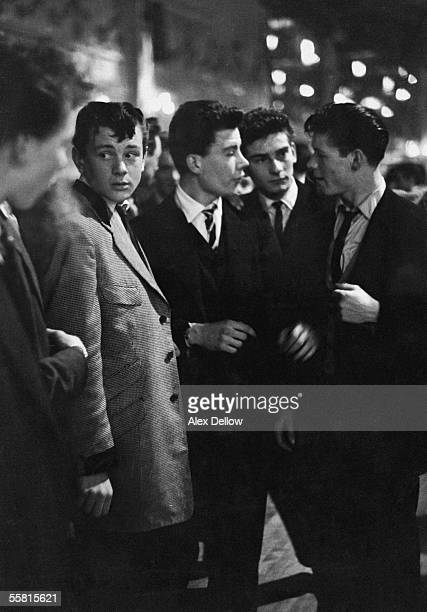 Group of teddy boys enjoy an evening out at the Mecca Dance Hall in Tottenham, London, 29th May 1954. Original publication: Picture Post - 7169 - The...