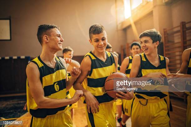group of teenage boys basketball players - south_agency stock pictures, royalty-free photos & images