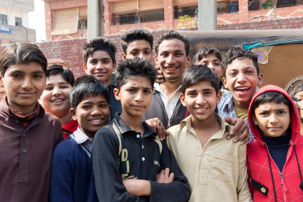 A group of teenage boys gathered on a street in front of a school on February 27 2014 in Lahore Pakistan Lahore is the capital city of the Pakistani..