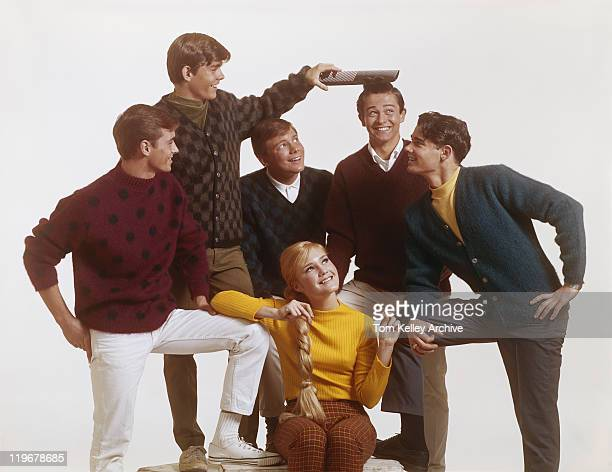 group of teenage boys with girl, boy combing friend's hair with big comb - archival stock pictures, royalty-free photos & images