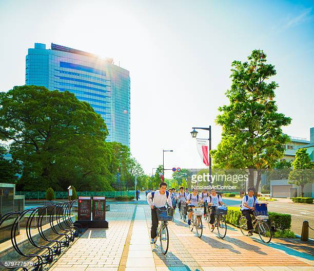 group of teenage cyclists on sidewalk in takasaki gunma japan - gunma prefecture stock photos and pictures