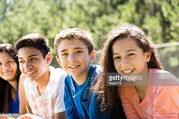group of teenage friends at local park or school campus. - 14 15 jahre stock-fotos und bilder