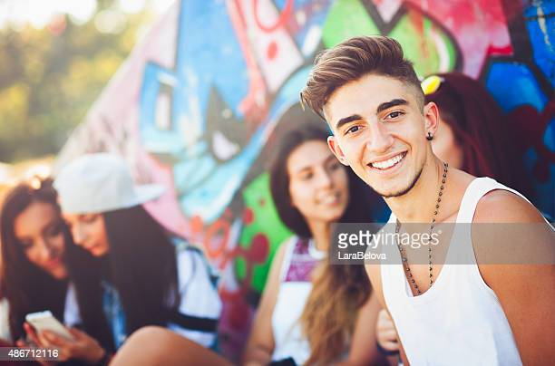 group of teenage friends - girl sitting on boys face stock photos and pictures