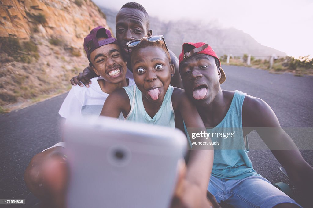 Group of teenage friends pulling faces for a selfie : Stock Photo