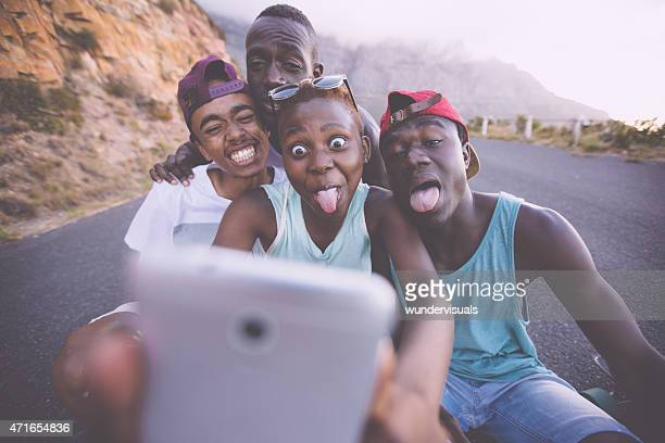 Group of teenage friends pulling faces for a selfie