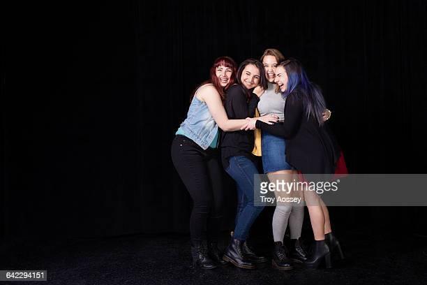 Group of teenage girls in a group hug.
