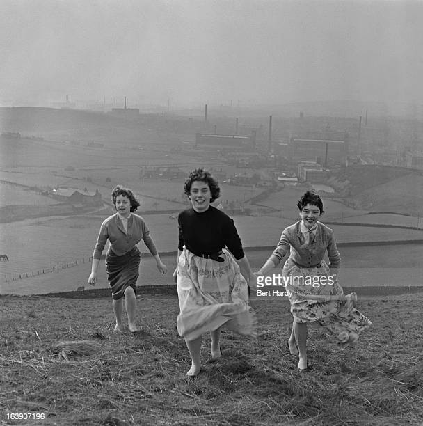 A group of teenage girls in the hills above the mill town of Shaw Lancashire 15th March 1957 Original publication Picture Post 8859 The Truth About...
