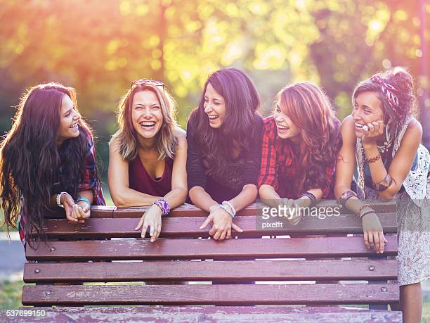 group of teenage girls in the park - girlfriend stock photos and pictures