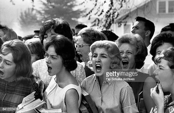 Group of teenage girls scream obscenities in front of their Montgomery, Alambama school against desegregation. The Supreme Court ordered the city to...