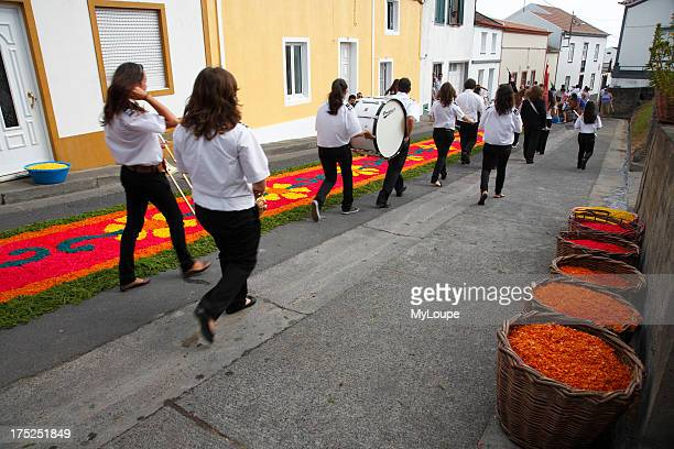 A group of teenage musicians heading for the church to take part in the procession of Nossa Senhora da Piedade Ponta Garca Sao Miguel island Azores