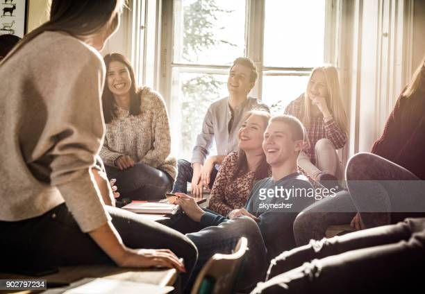 Group of teenage students talking and having fun on a break.