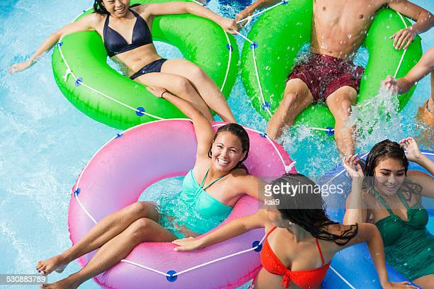 Group of teenager at water park on lazy river