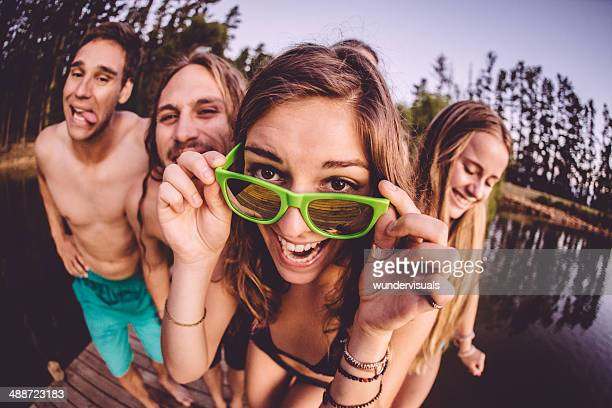 Group of teenager having fun by the lake