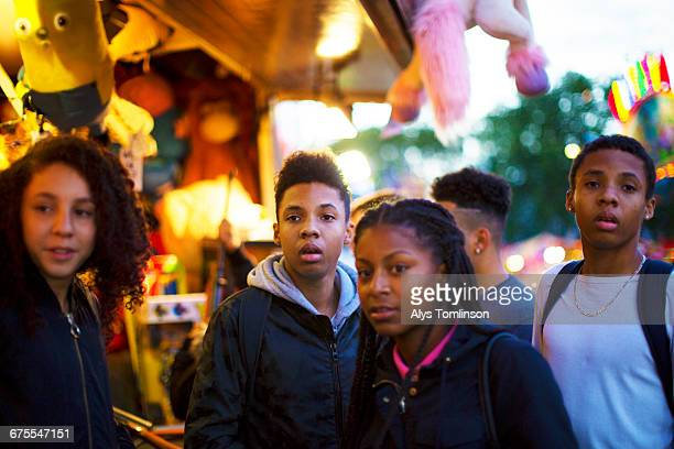 group of teenagers at fairground - carnival stock pictures, royalty-free photos & images