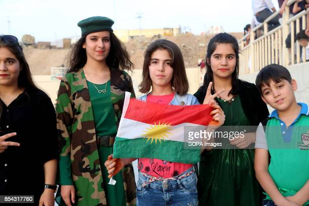 A group of teenagers at polling station are pictured while supporting the referendum September 25 2017 is a historic day for Kurdish people around...