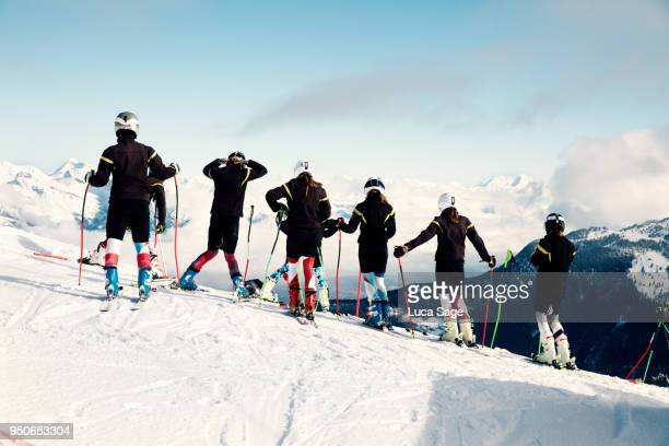 a group of teenagers at ski school race training in verbier, switzerland - ski racing stock pictures, royalty-free photos & images