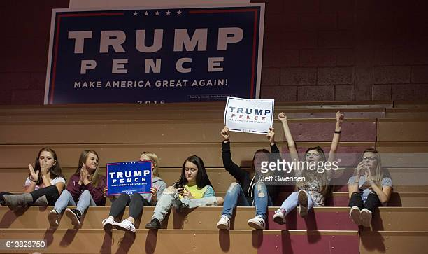 Group of teenagers listen to Republican candidate for President Donald J Trump speak to supporters at a rally at Ambridge Area Senior High School on...