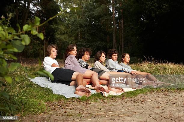 group of teenagers lying on blanket - 横向きに寝る ストックフォトと画像