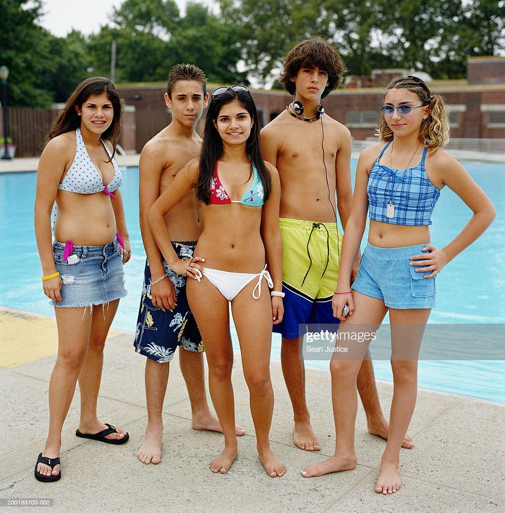 Group of teenagers (13-16) near pool, portrait : Stock Photo