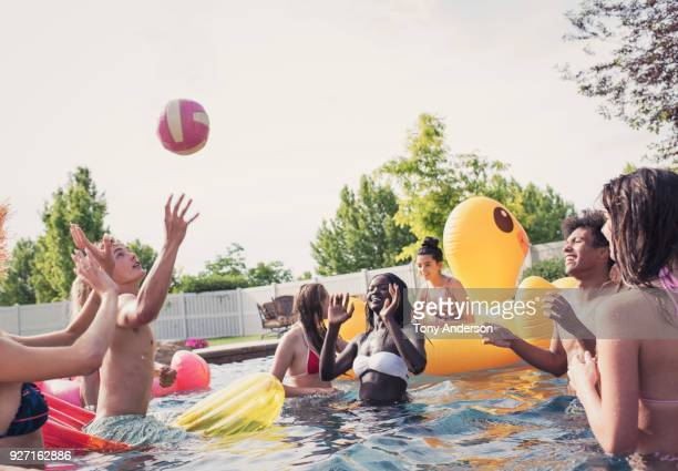 Group of teenagers playing in pool