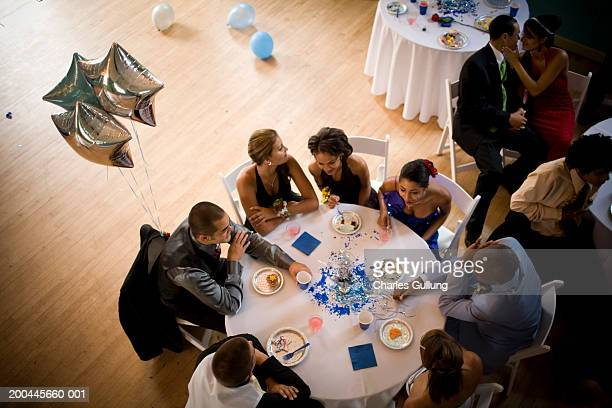 group of teenagers (15-18) sitting at tables at prom, elevated view - prom stock pictures, royalty-free photos & images