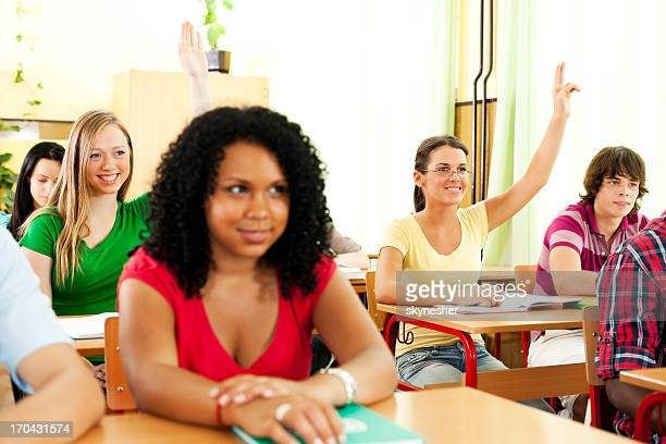 Group of teenagers sitting in the classroom.