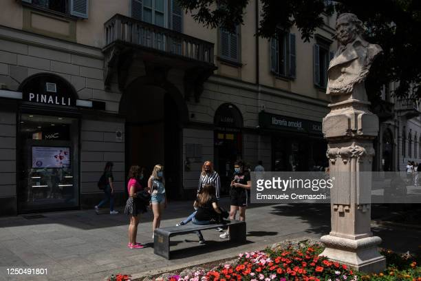 Group of teenagers stand in a pedestrian street in the Lower Town on June 18, 2020 in Bergamo, Italy. The city of Bergamo is slowly returning to...