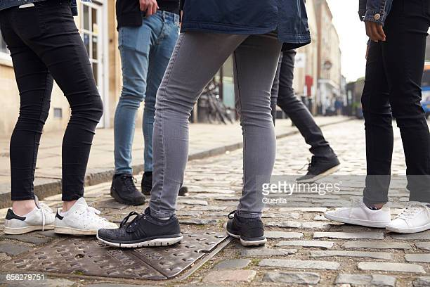 Group Of Teenagers Standing On Street In Urban Setting