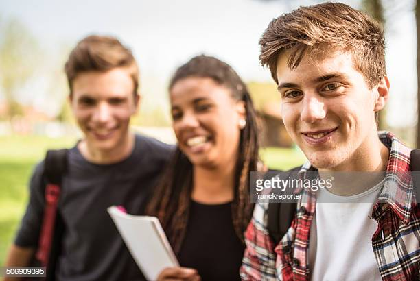 group of teenagers student outdoors laughing