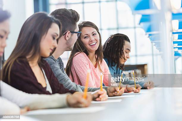 group of teenagers taking a test - college application stock photos and pictures