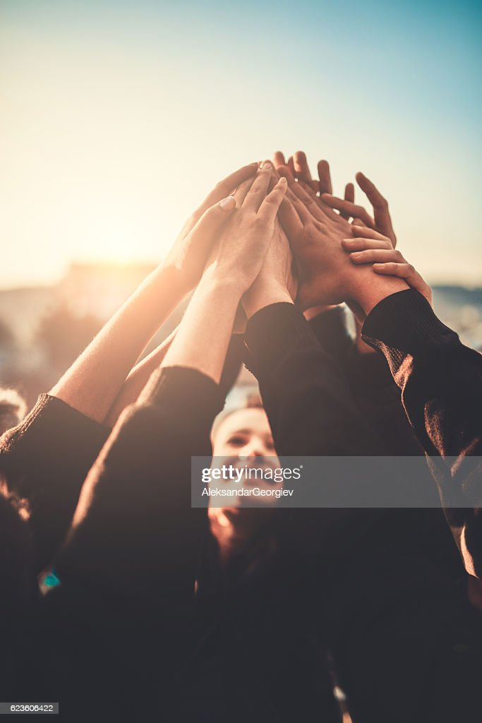 Group of Teenagers Volunteer with Raised Hands to the Sky : Stock Photo