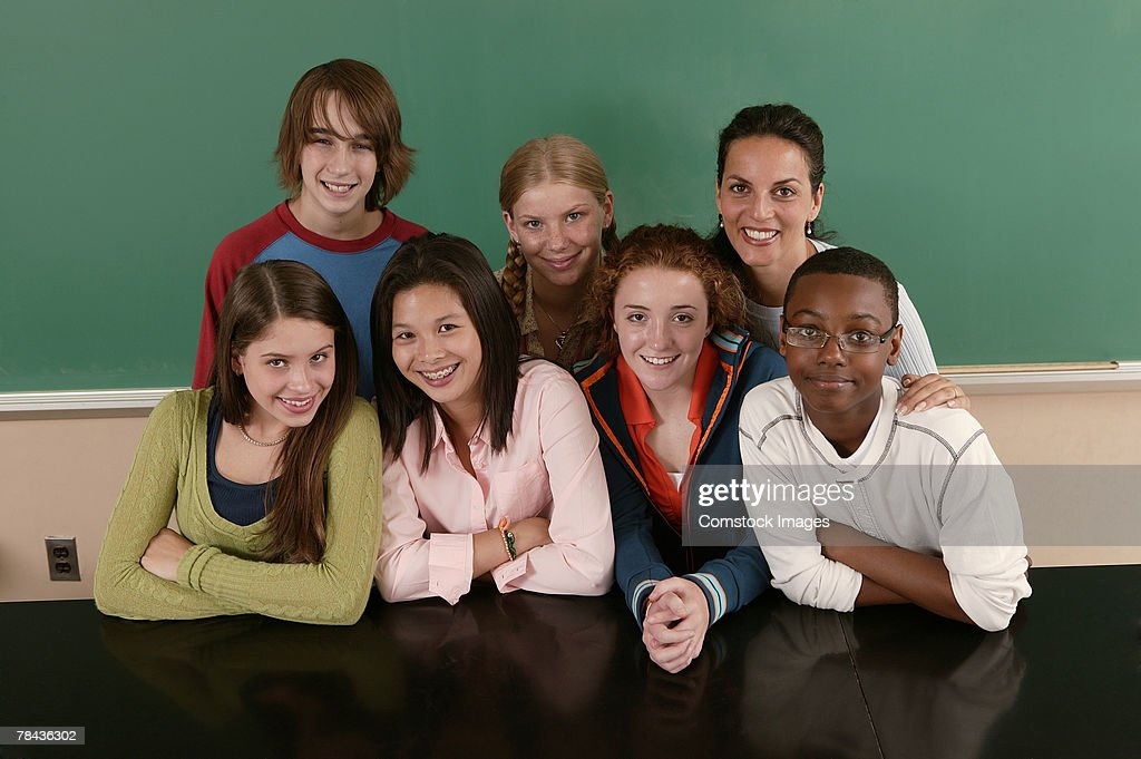 Group of teenagers with teacher at school : Stockfoto