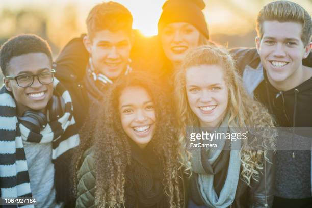 Group of teens at sunset