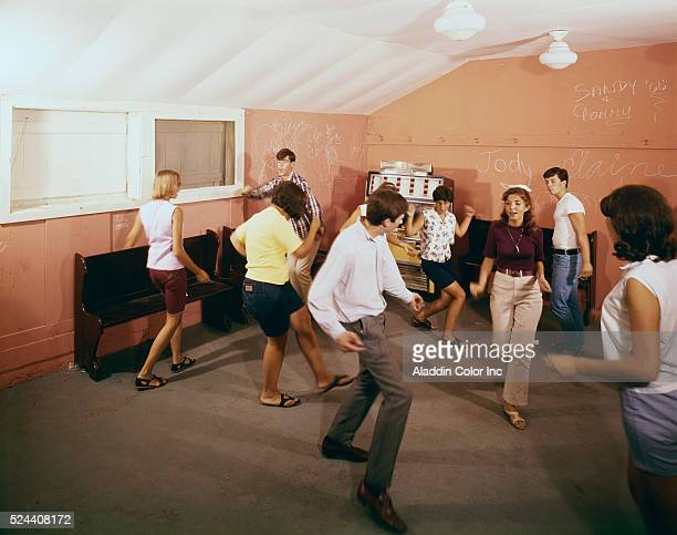 A group of teens dancing at the Louis Lake House | Location Swartswood New Jersey USA