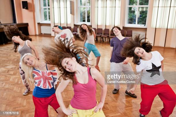 group of teens dancing - dance troupe stock photos and pictures