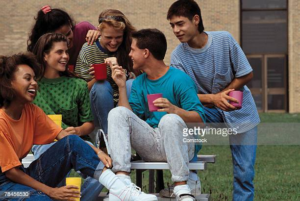 Group of teens hanging out together
