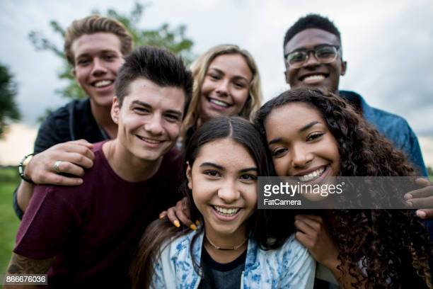 group of teens - adolescence stock pictures, royalty-free photos & images