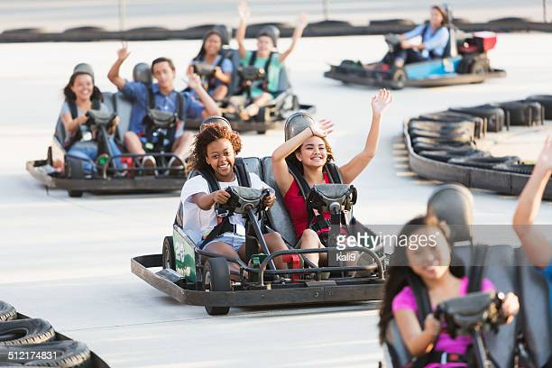 group of teens riding go carts - go cart stock pictures, royalty-free photos & images