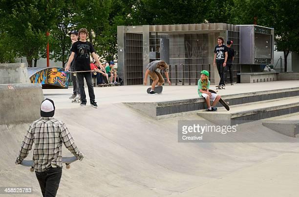 Group of teens skateboarding at park at the Forks, Winnipeg