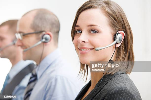 group of telecommunication call center people with head sets - surrey england stock photos and pictures